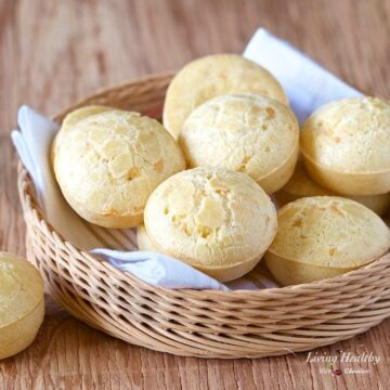 basket of Brazilian cheese bread on wooden table